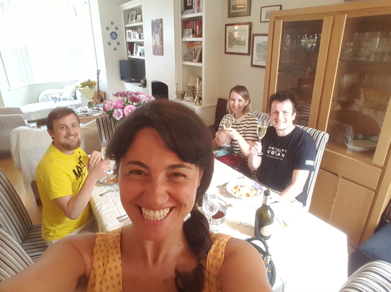 Mariacristina and George sitting at the dining table with George's stem cell donor Tim and his family
