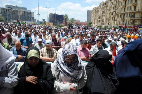 2016-09-12-1473678287-9365499-Friday_prayer_in_Tahrir_Women_Ahead_of_men.jpg