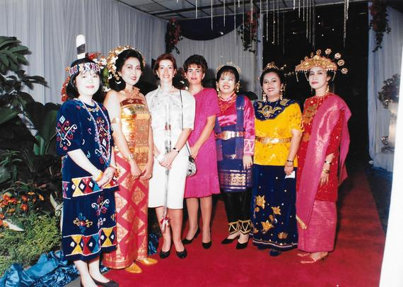 2016-09-13-1473768152-2684156-JeanConsulIndonesia1995withIndonesianstaffinnationalcostume.jpg
