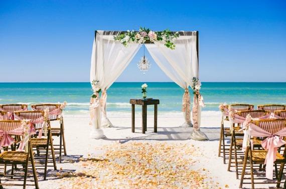 2016-09-23-1474622807-5211401-Beachwedding.jpg
