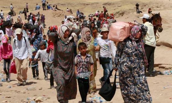 2016-10-07-1475860146-6213007-Syrianrefugeeswomenchildrendesert_620.jpg
