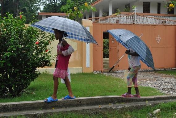 2016-10-09-1476055846-8744779-Haitiumbrellagirls.JPG