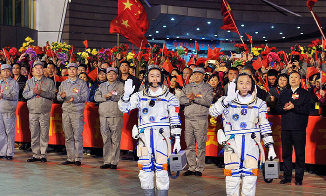 Chinese astronauts enter space station following docking