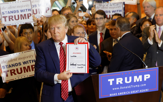 2016-11-19-1479548625-5976990-Donald_Trump_Signs_The_Pledge_25_WikipediaMichael_VadonEdit01a.jpg