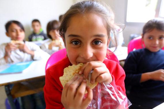 2016-11-22-1479819295-2667104-SyriangirleatsTheirworldsnackatMteinSchoolinLebanonpictureTheirworldHusseinBaydoun.JPG