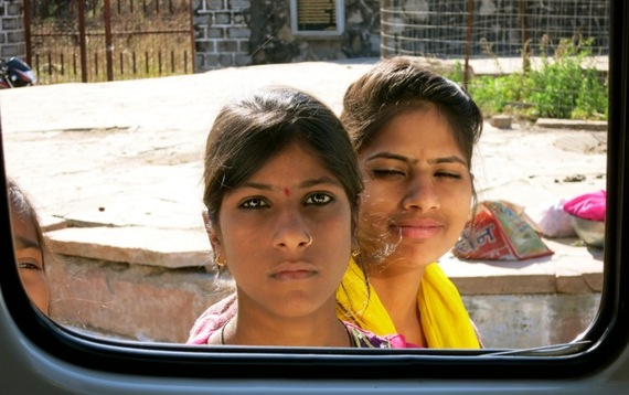 2017-01-13-1484309366-152946-GirlsThroughWindowIndia.jpg