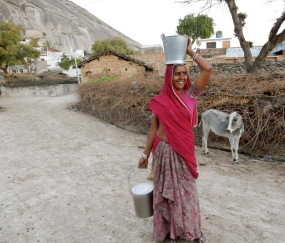 2017-01-13-1484309654-7383516-WomanWithWaterNarlaiIndia.jpg