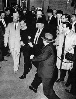 2017-01-23-1485194187-4430036-Lee_Harvey_Oswald_being_shot_by_Jack_Ruby_as_Oswald_is_being_moved_by_police_1963250px.jpg