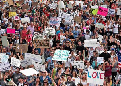 2017-01-30-1485817572-8330576-notmypresidentprotests.jpg