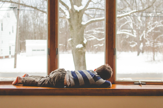 2017-02-07-1486506594-8756174-ChildLyinginWindowWinterOutside.jpg