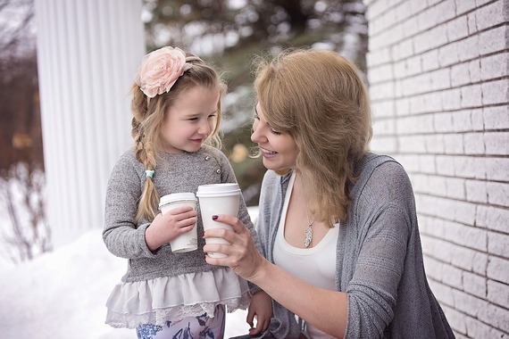 Mother and Daughter sharing Hot Beverage