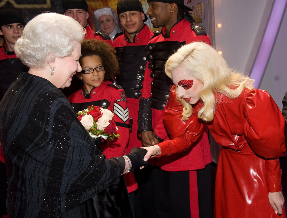 night in London as she met Lady Gaga, who wore red leather and curtsied,