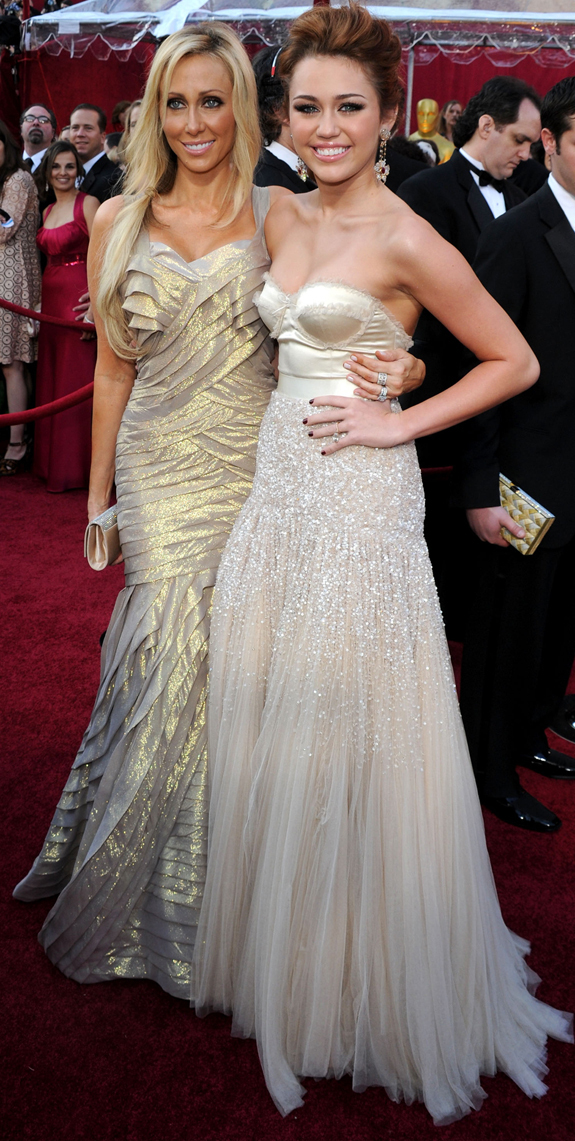 Miley Cyrus Oscars 2010 Photos Golden Strapless With Her