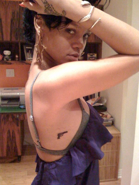 Rihanna gets a gun tattoo photos